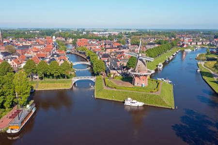 Aerial view on Dokkum with windmills Zeldenrust and De Hoop in the Netherlands