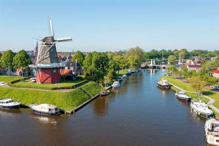 Aerial view on Dokkum with windmill De Hoop in the Netherlands