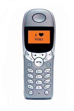recibo: Tel�fono m�vil con TE AMO sms Foto de archivo