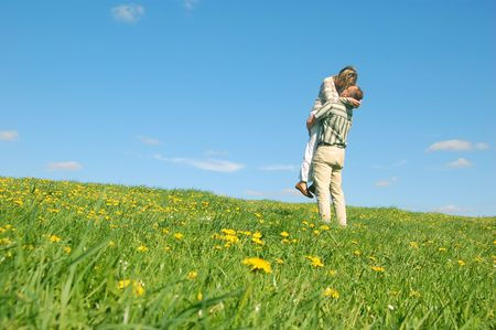 Couple in love having fun on spring meadow Stock Photo - 1105606