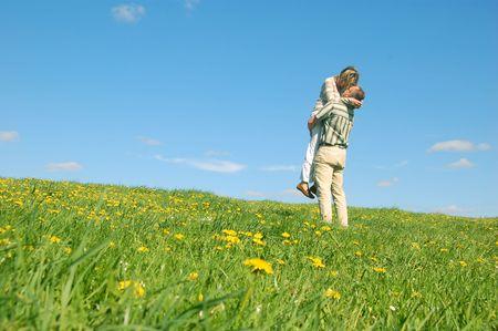 Couple in love having fun on spring meadow Stock Photo - 1105606