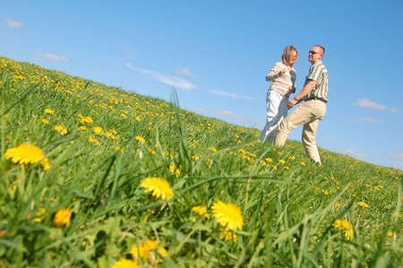Couple in love having fun on spring meadow photo