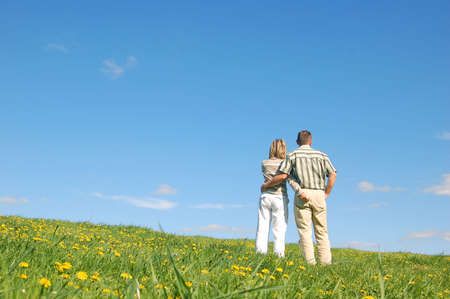 Couple in love on spring meadow photo