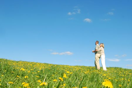 endearing: Couple in love on spring meadow Stock Photo