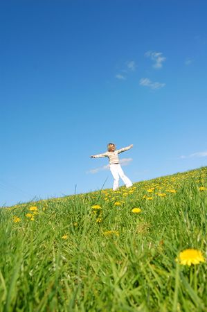 Happy woman having fun on spring meadow photo