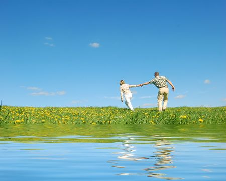 endearing: Couple in love having fun on spring meadow
