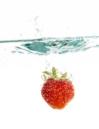 Strawberry jumping into water photo
