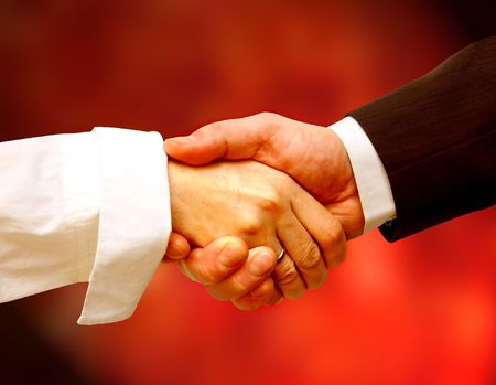 Business handshake against red background Stock Photo
