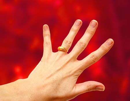 Woman hand with gold ring on white background Stock Photo - 1126131