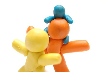staying in shape: Happy . 3 plasticine figures Stock Photo