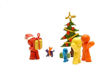 Plasticine figures staying together and celebrating christmas time, Santa Clous giving away presents