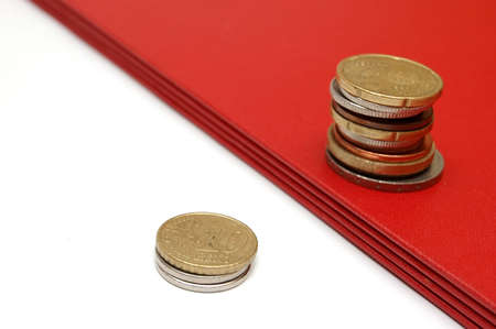 finanical: Two coins towers isolated Stock Photo
