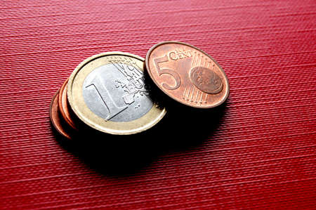 finanical: Euro coins on red surface