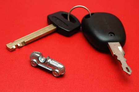 Car keys and little car toy on red background Stock Photo - 1133640