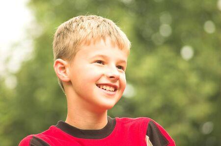Laughing boy summer portrait photo