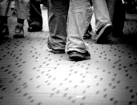 alone in crowd: Walking through the street crowd