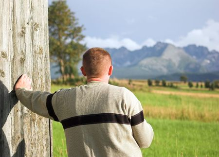 Man looking at mountains scenery photo