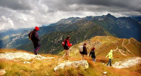 Tatra Mountains stormy landscape panorama and hikers walking Stock Photo - 1134554