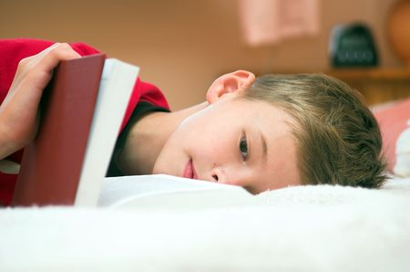 Young boy is tired, but must studying photo