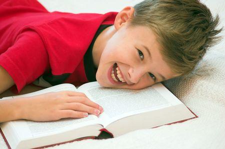 Schoolboy having fun during studying photo