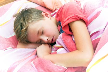 Sleeping boy in bed Stock Photo