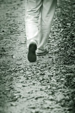 footing: Walking through the autumn leaves