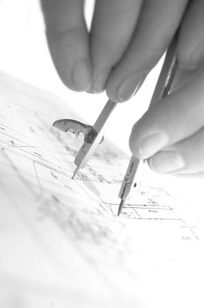Archritect works on plan papers photo