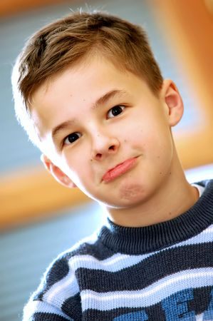 hope indoors luck: Portrait of young boy thinking Stock Photo