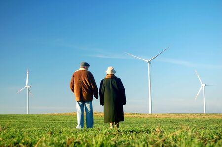 Seniors' couple looking on wind turbines Stock Photo - 3100353