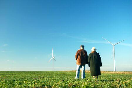 Seniors' couple looking on wind turbines Stock Photo - 3100361