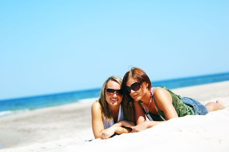 Young attractive girls enjoying together the summer beach Stock Photo - 3206847