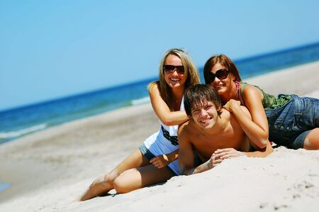Young attractive friends enjoying together the summer beach Stock Photo - 3207358