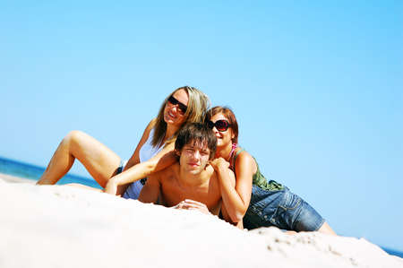 Young attractive friends enjoying together the summer beach Stock Photo - 3207229