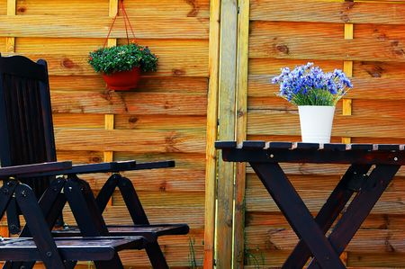 Outdoor design composed with wooden furniture and flowers photo