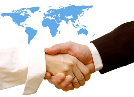 Agreement handshake. World map in the background, conceptual Stock Photo