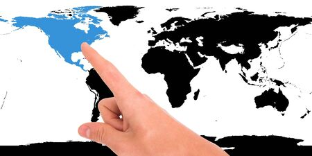 Hand pointing on world map. North America highlighted photo