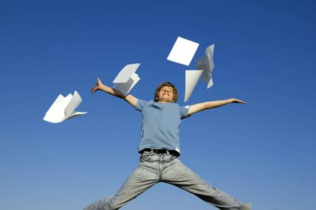Happy boy throw up pieces of paper. The start of holiday Stock Photo - 3259255