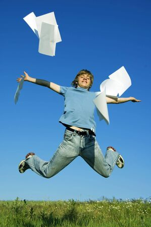 Happy boy throw up pieces of paper. The start of holiday Stock Photo - 3259270