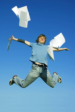 Happy boy throw up pieces of paper. The start of holiday Stock Photo - 3259260