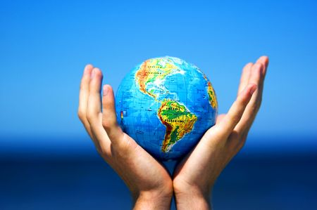 small world: Earth globe in hands protected. Ideal for Earth protection concepts, recycling, world issues, enviroment themes