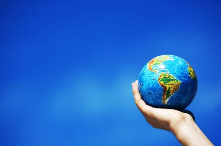 Earth globe in hand protected. Ideal for Earth protection concepts, recycling, world issues, enviroment themes photo