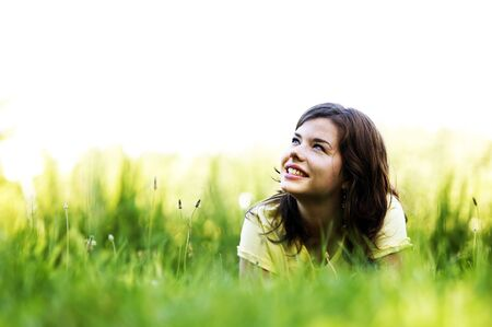 Pretty smiling girl relaxing outdoor photo