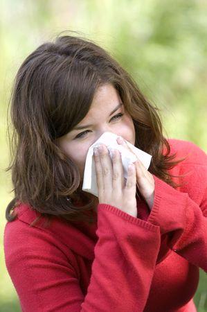 Pretty woman sneeze. Allergy season Stock Photo - 3293031
