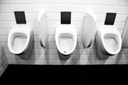 Photo of public toilet urinals photo