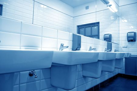 public houses: Public toilet with several sinks Stock Photo
