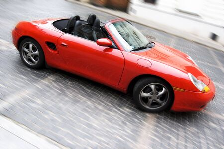 Red sport car on a road