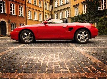 expensive car: Red sport car in the old town scenery Stock Photo