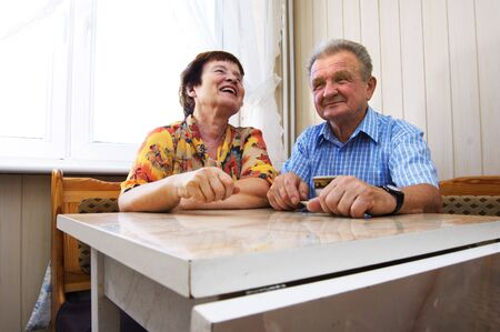 Happy senior couple in kitchen Stock Photo - 3581431