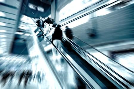 Shopping center, escalator people moving photo