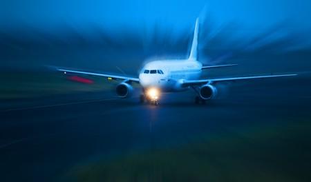 landing light: Plane takes of at dusk. Motion blured concept